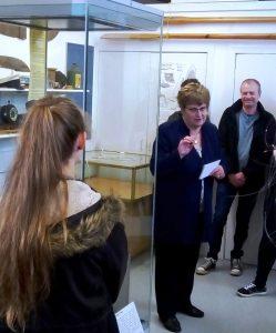 Annie MacSween showing the museum at Comunn Eachdraidh Nis, Ness