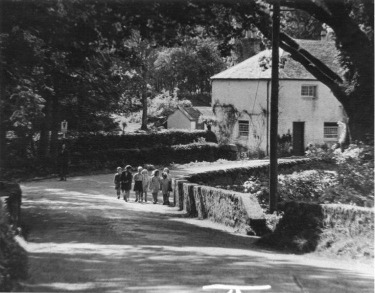 Buchanan school building and children in the foreground - 1938