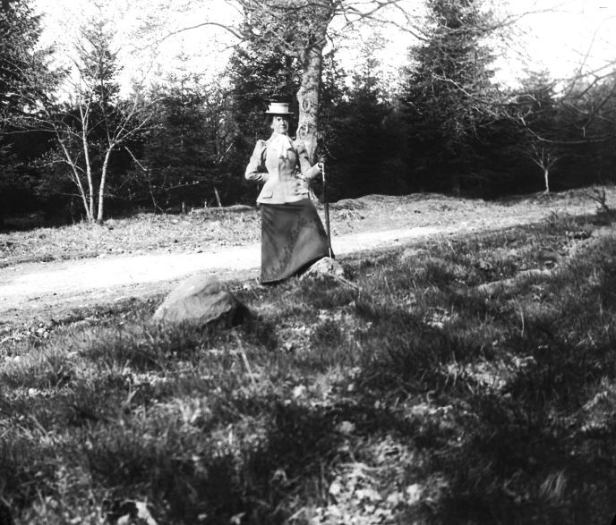 Lady on a country road c.1900